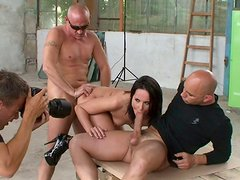 Sporty brunette hooker Andy Brown does anal in threesome