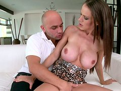 Busty McKenzie Lee blows huge dick of a handsome guy on a couch