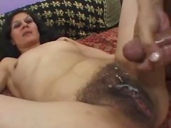Mature brunette gets her vag fucked and covered with cum