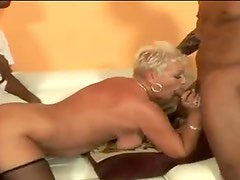 Two black dudes pound a curvy mature blonde