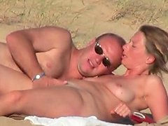 Horny French dude drills his wife's pussy on a beach
