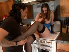 Beautiful brunette Rucca Page playing with banana in the kitchen