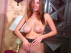 Redhead with big boobies is posing and masturbating