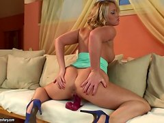 Kathia Nobili fingers her pussy before smashing it with a dildo