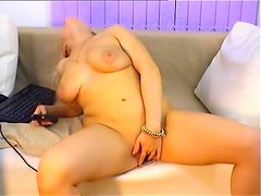 Webcam gal strips and fingers her cunt