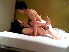 Oriental couple fucking on home vid