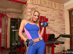 Amazing Regina Ice toys her smooth pussy in a gym