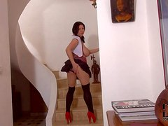 Turned on black haired mature bitch Kora in sexy schoolgirl