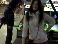 Dark haired beauty Nika is enjoying some shooting game at the arcade before hardcore drilling
