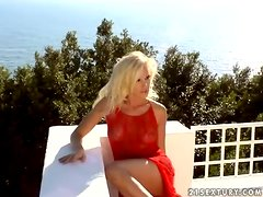 Sophie Moone plays with her nice pussy on the balcony