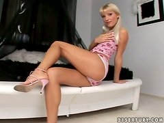 Jordan Green the pretty blonde with pigtails fingers her pussy