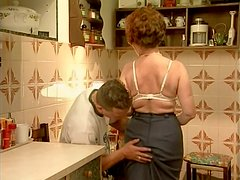 Curly slutty gammer Sabrina sucks a stiff cock in the kitchen