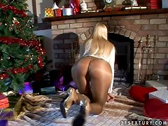Boxing Day babe plays with her pussy by the fire