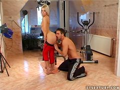 Debbie White gets fucked in missionary position in a gym