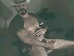 Bearded Cowboy is smoking and jerking