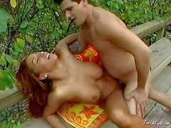 Arousing cheep long haired brunette hooker with big juicy jugs