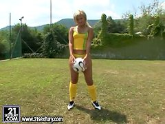 Nasty blonde Candy toys her asshole on a football field