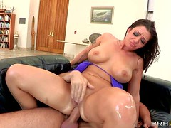 Melina Mason is a curvy brunette with huge tis and