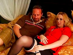 Arousing golden haired milf gets her big boobs touched by a nasty and turned on lad