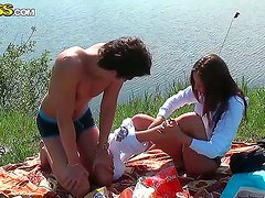 Abbey and her lover get their clothes off in the nature by the lake and enjoy in their picknic