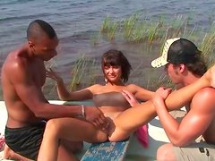Slim brunette with small tits gets her wet pussy tickled in the boat