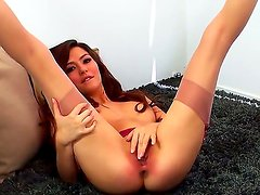 Glamorous Cassie Laine with small boobs and long legs in stockings and high heels fingers her sweet twat