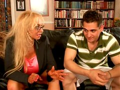 Voracious blonde cougar Echo Valley with giant boobs gives tremendous titjob