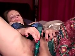Bigtitted mature mom spunks onto her rubber toy
