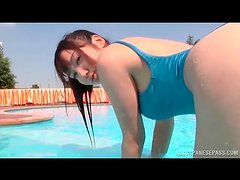 Japanese chick gets all wet in the pool