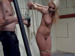 Slim blonde teen with whorish make and hands tied up