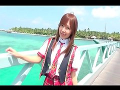 Asian teen models schoolgirl outfit outdoors